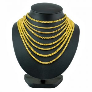 gold necklaces placed on a black jewelry bust stand