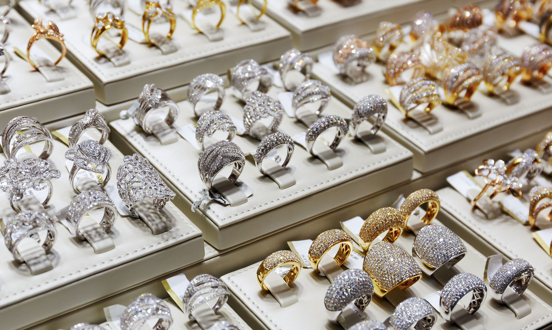 mixture of gold and diamond jewelry on display