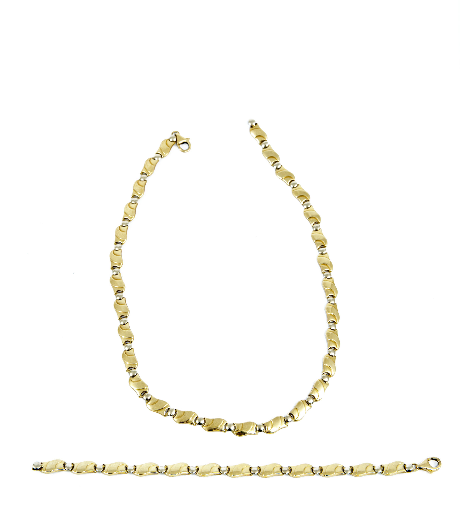 two gold necklaces laid flat on white background