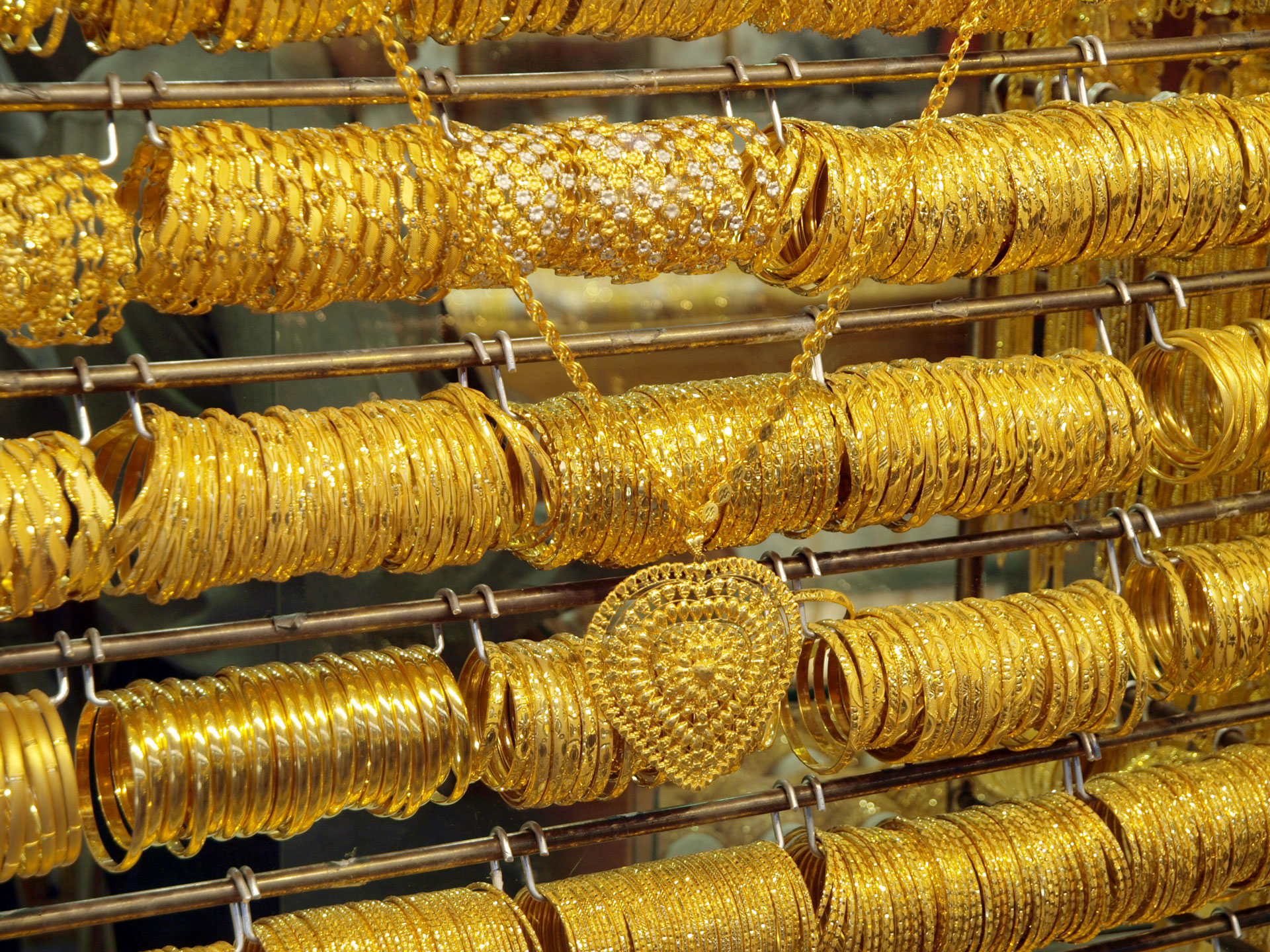 Racks of gold bracelets and gold necklace