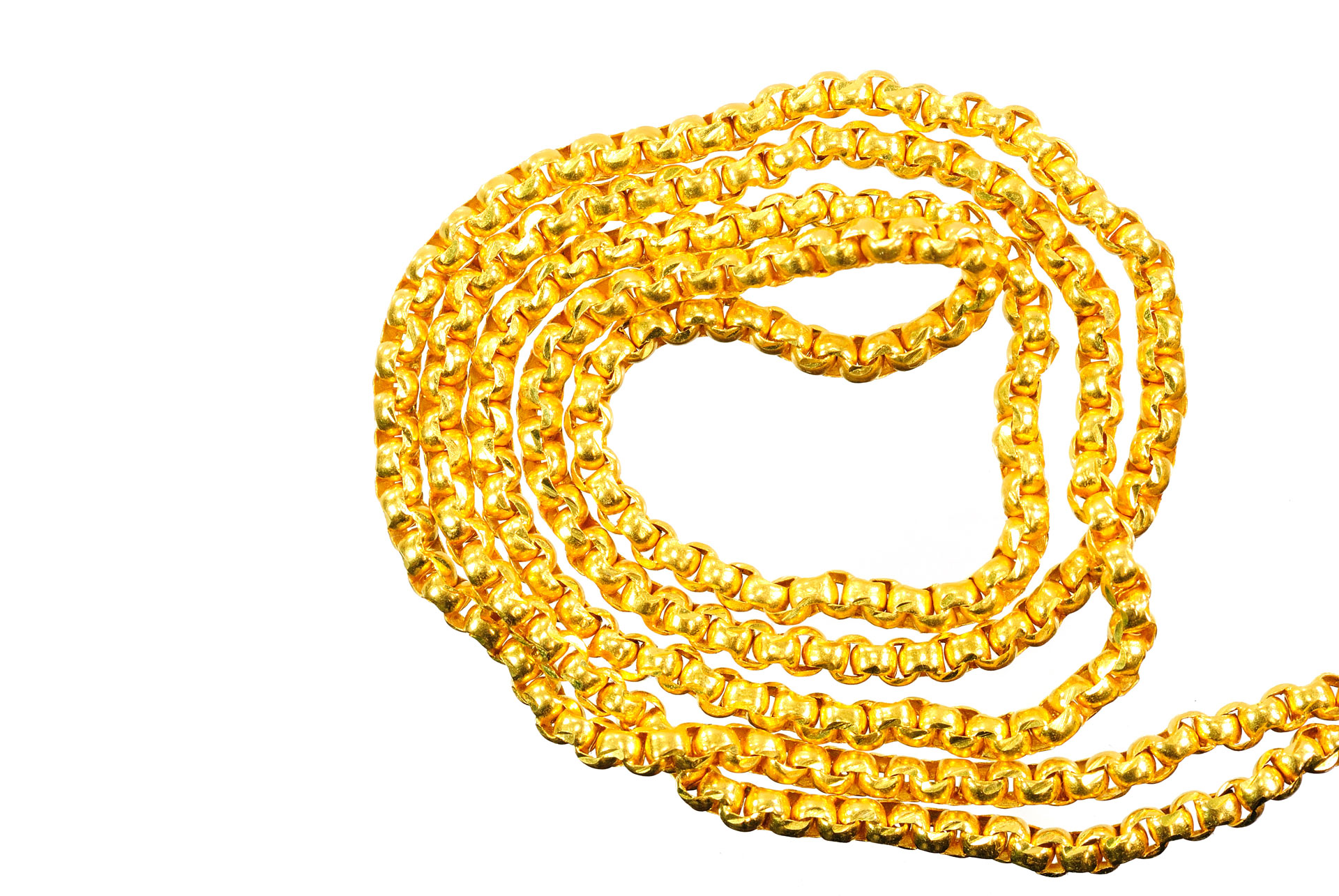 Gold necklace placed in a spiral shape