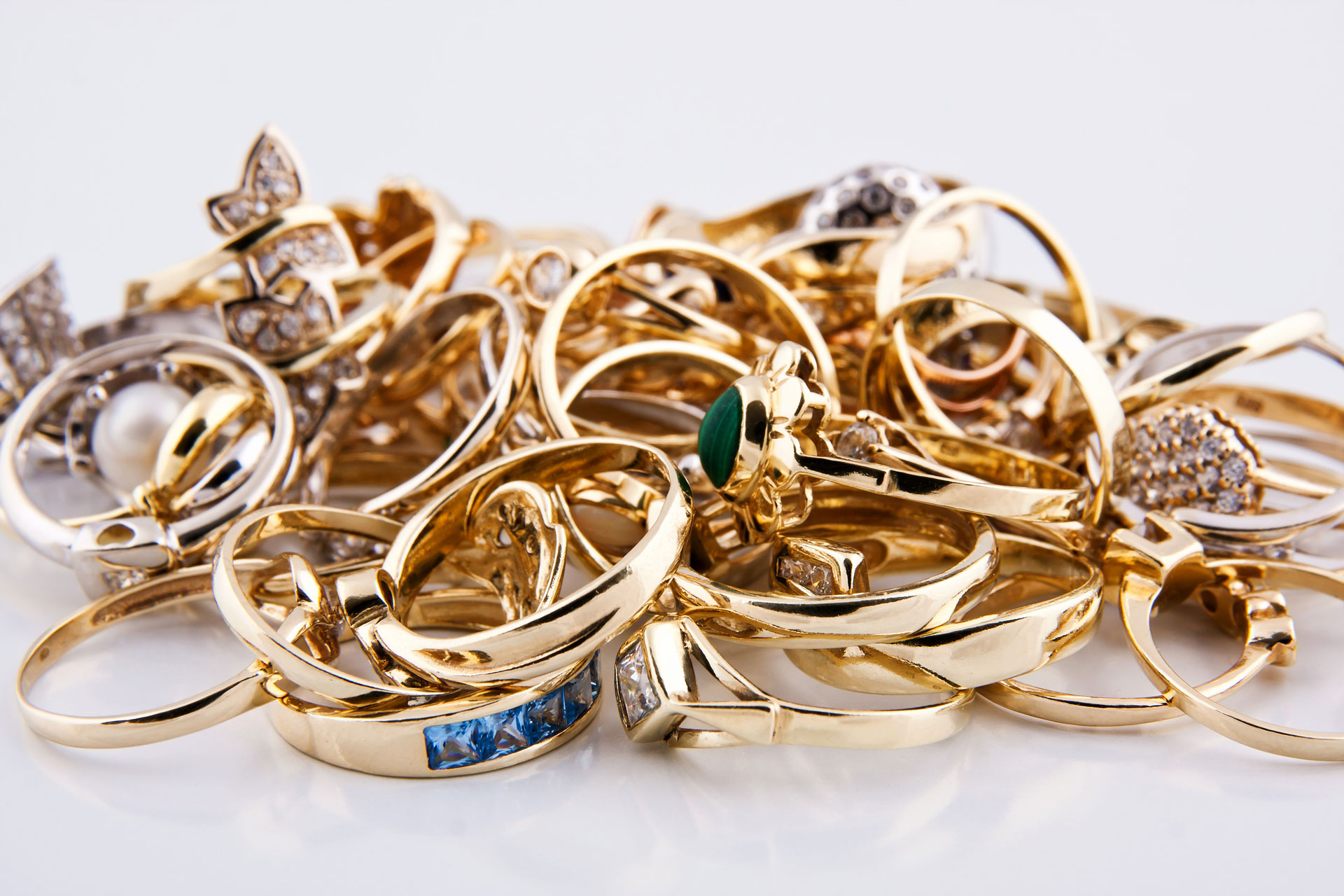 pile of gold ring jewelry