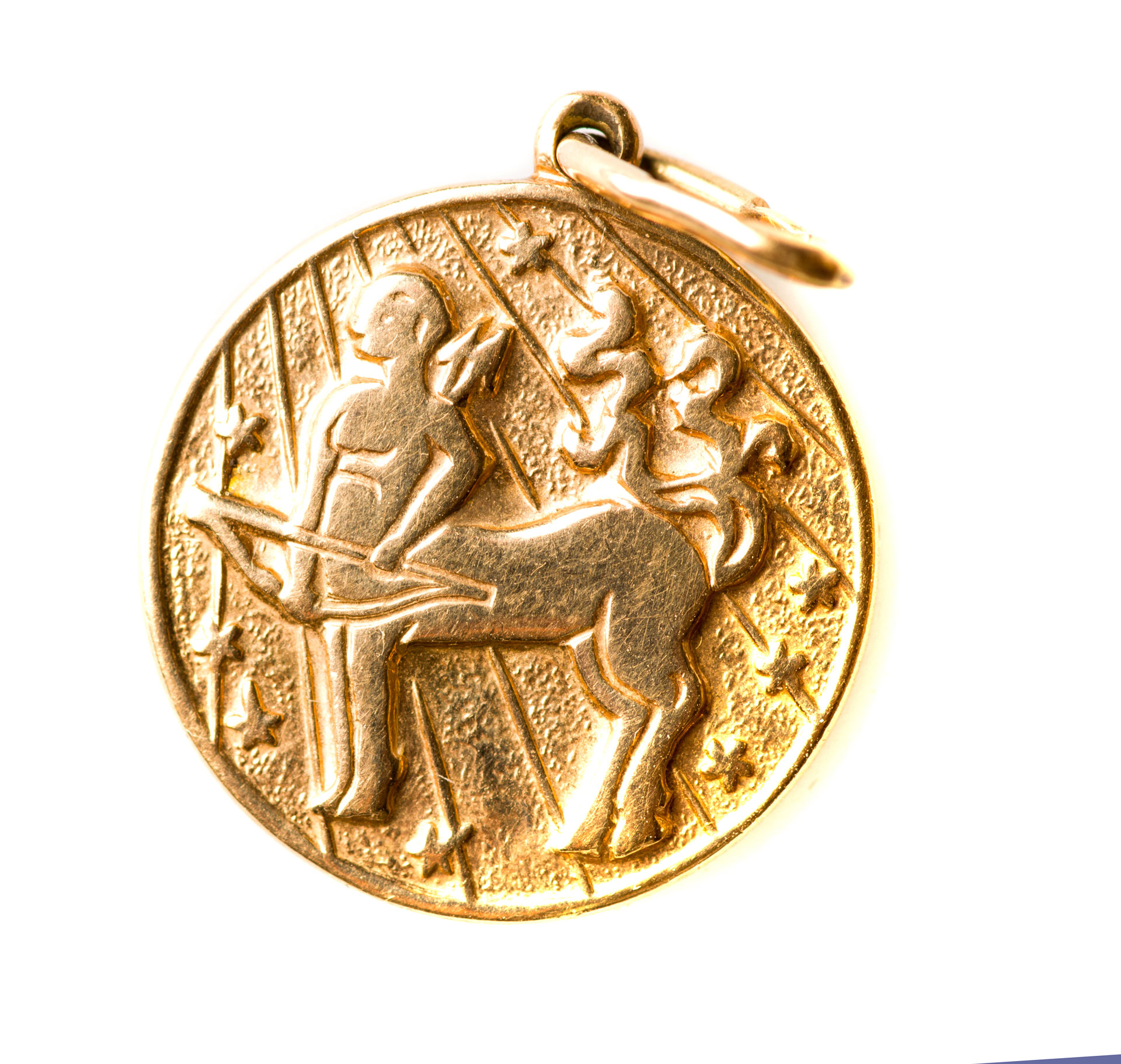 gold jewelry with centaur figure